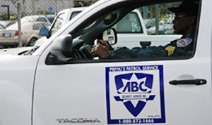 ABC security officer in car